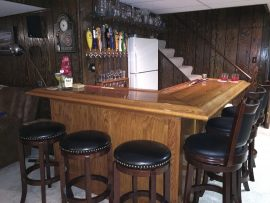 Finished custom home oak bar - corner view