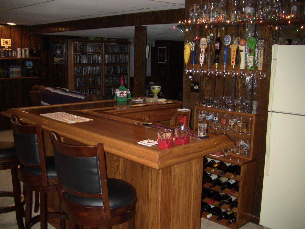 Final oak home bar with stools, back bar and Christmas lights